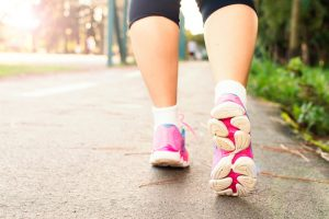 lower legs with pink trainers - Benefits of walking on a treadmill
